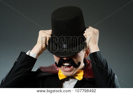Funny magician man wearing tophat