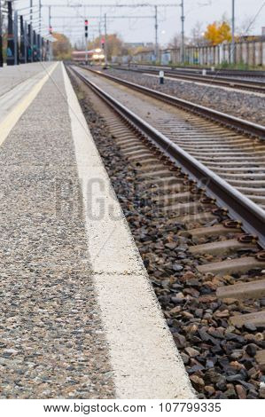 Railroad Track, Platform And Train