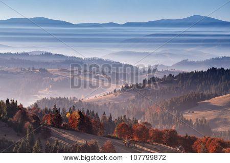 Striped fog in Carpathians. Goog autumn day