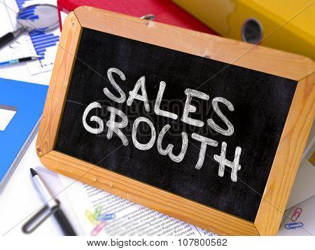 Handwritten Sales Growth on a Chalkboard.