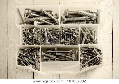 Tool box with screws and bolts.