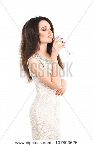 party, drinks, christmas, x-mas concept - smiling woman in white dress with a glass of champagne