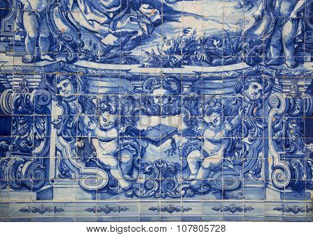 PORTO-PORTUGAL NOVEMBER 4, 2015:  Detail of Santa Catarina chapel in Porto built in the18th century, the facades are completely covered tile panels in blue and white painted in 1929 by Eduardo Leite.