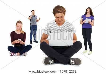 Studio Shot Of Teenagers Using Communication Technology