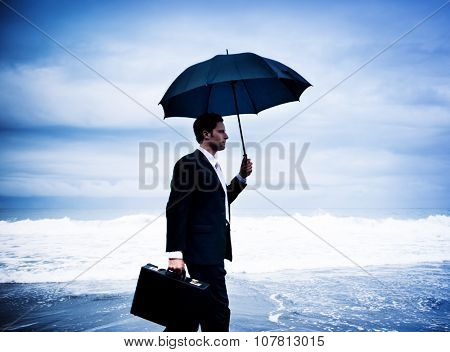 Lonely Businessman Walking by the Beach Concept