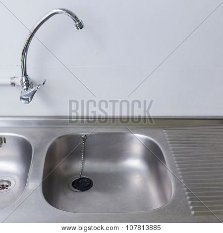 Stainless Steel Sink And Faucet In White Kitchen Room