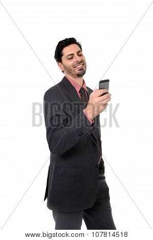 Corporate Portrait Of Young Attractive Businessman Of Latin Hispanic Ethnicity With Mobile Phone