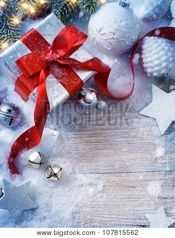 Art Christmas Background With Fir Tree And Gift Box In Snow
