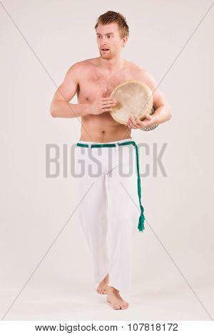 Capoeira Dancer Play Drums
