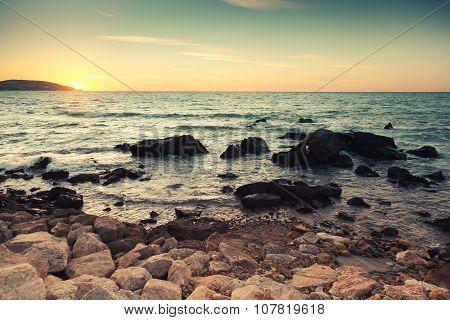 Coastal Stones And Sea Water At Sunset