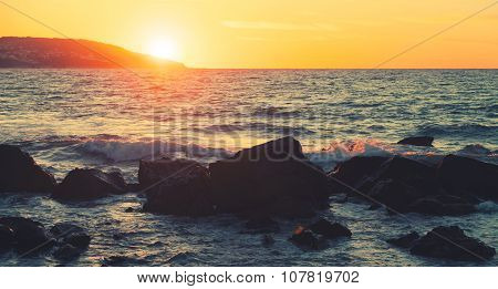 Coastal Stones And Sea Water At Summer Sunset