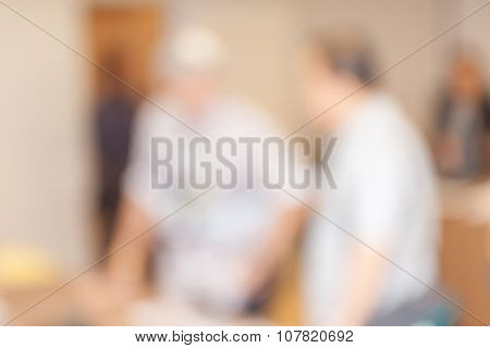 Blurred Photo Of People Talking About Business In Conference Event Hall.