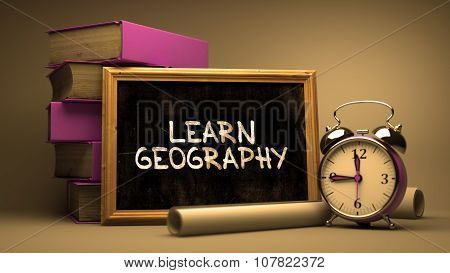 Learn Geography - Chalkboard with Inspirational Quote.
