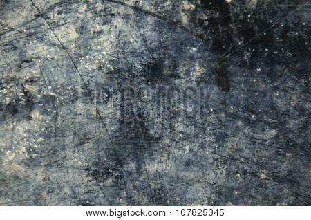 closeup dark grunge textured wall (blurry background)