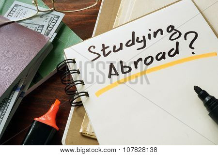 Notepad with Studying Abroad? on a table.