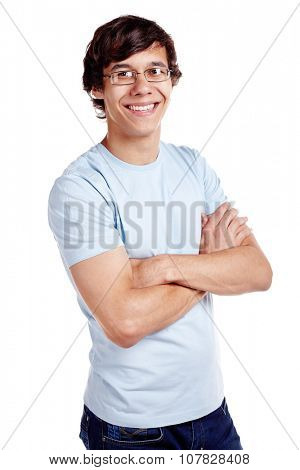 Portrait of young hispanic man wearing glasses, blue t-shirt and jeans standing with crossed arms and smiling isolated on white background