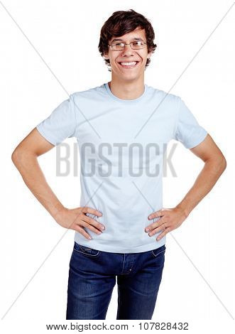 Portrait of young hispanic man wearing glasses, blue t-shirt and jeans standing with hands on hips and smiling isolated on white background