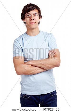 Portrait of young hispanic man wearing glasses, blue t-shirt and jeans standing with crossed arms isolated on white background