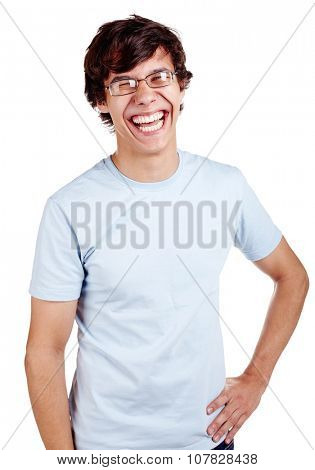 Portrait of young hispanic man wearing glasses, blue t-shirt and jeans standing with hand on his hip and loudly laughing isolated on white background - laughter concept
