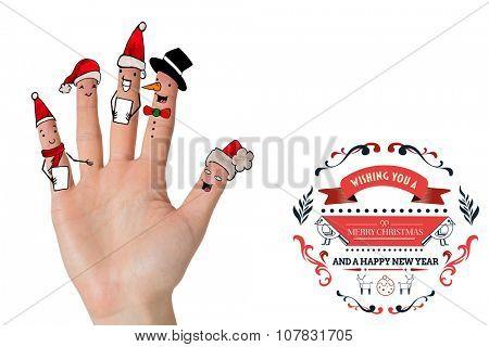 Christmas caroler fingers against christmas greetings