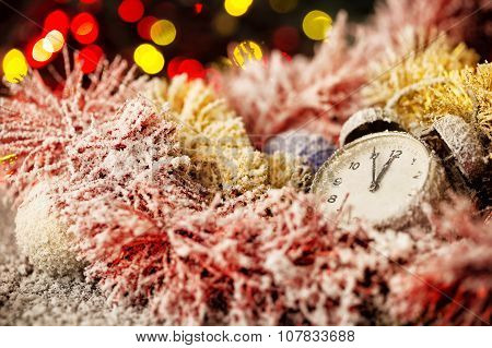 Clock in snow-covered Christmas ornaments