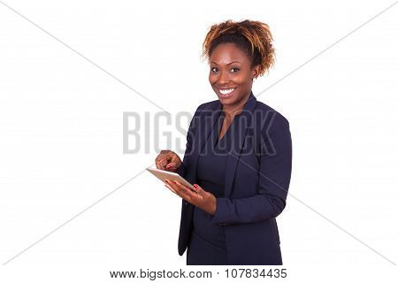African American Business Woman Using A Tactile Tablet Computer