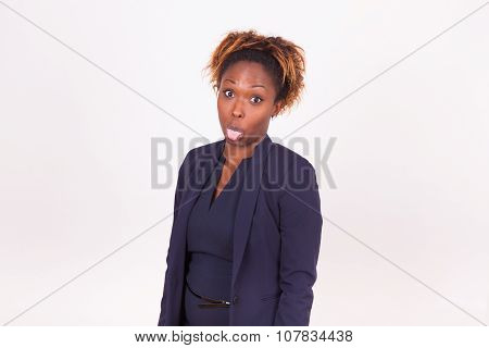 African American Business Woman Sticking Tongue Out