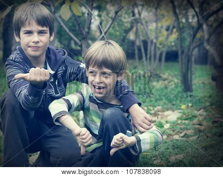 happy brothers playing in the park
