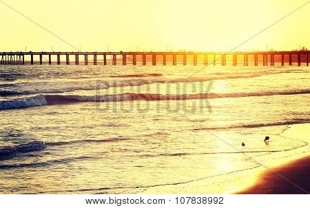 Vintage Toned Wooden Pier On Beach At Sunset, California, Usa