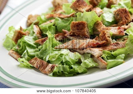 Caesar salad with lettuce, croutons, and turkey meat