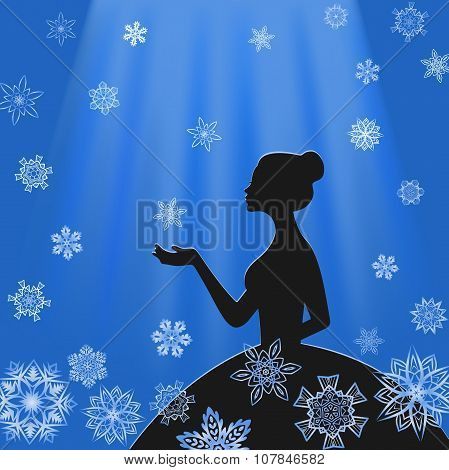 Girl in profile with snowflakes in light blue beams