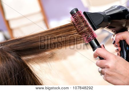 Hairdresser Blow Drying Long Brown Hair