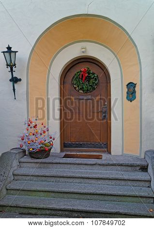 Entrance decorated for the holidays with wreath and red bow. Garmisch-Partenkirchen small Bavarian town in south Germany.