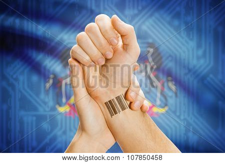 Barcode Id Number On Wrist And Usa States Flags On Background - Pennsylvania