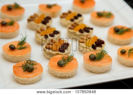 canape with red fish and butter