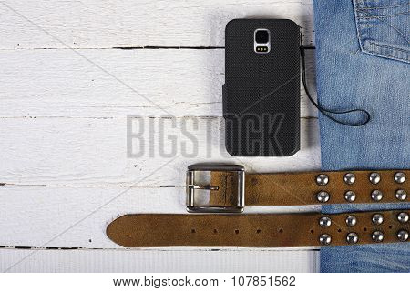 Planks, Phone, Blue Jeans And Belt