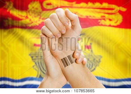 Barcode Id Number On Wrist With Canadian Province Flag On Background - New Brunswick