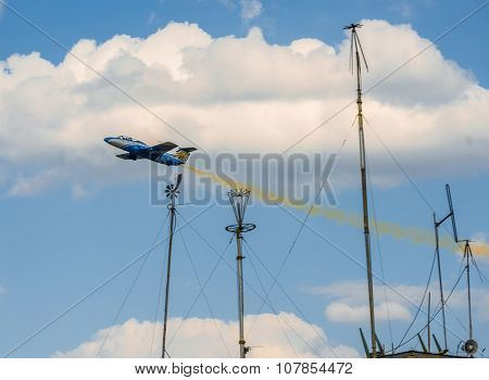 UKRAINE, KHARKIV -AUGUST 24:  airplane in the sky with yellow smoke on UkraineIndependence Day in Kharkiv  on August 24, 2015