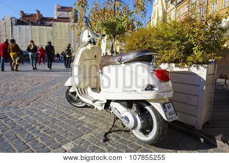 Vespa Scooter Parked At A Market In Warsaw