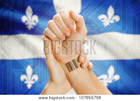 Barcode Id Number On Wrist With Canadian Province Flag On Background - Quebec
