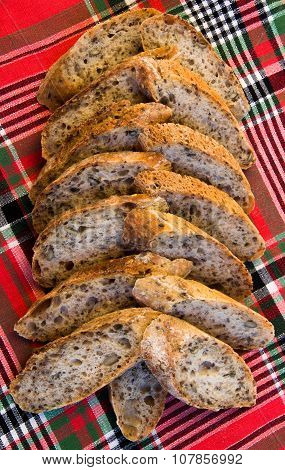 Slices Of Alpine Baguette In The Shape Of Christmas Tree On Scottish Tartan Background.