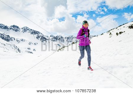 Happy Woman Winter Trail Running In Beautiful Inspirational Landscape