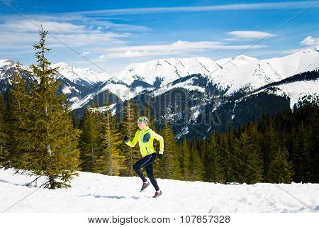 Happy Woman Running In Mountains On Winter Snow