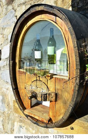 Wineglasses and barrel