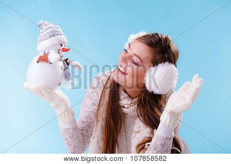 Cute Woman With Little Snowman. Winter Fashion.