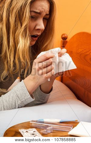 Sick Woman In Bed Sneezing In Tissue. Cold.
