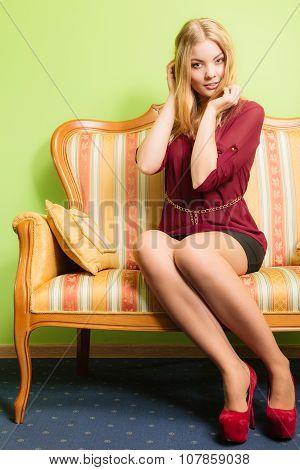 Pretty Young Woman On Vintage Sofa. Fashion.