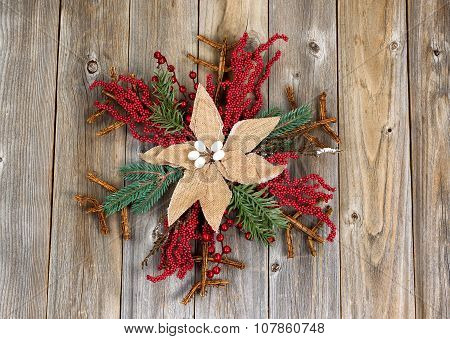 Christmas Wreath With Cloth Flower On Rustic Wooden Boards