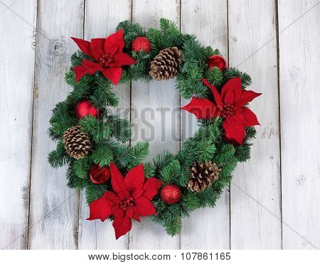 Holiday Poinsettia Christmas Wreath On Rustic White Wooden Boards