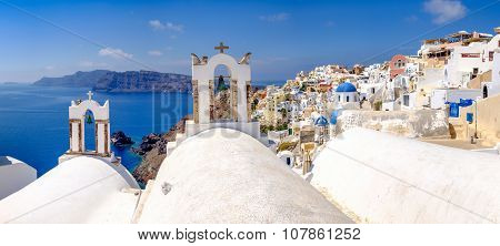 Panoramic View At Rooftops Of Romantic Village In Santorini